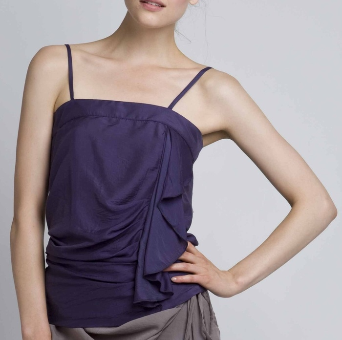Top with frilled front, 65% M. Mod, 23% Pol & 12% Silk.