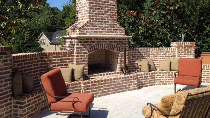 Outdoor Isokern Fireplace finished with brick and lots of seating - love the color pallet! Installed/Finished by Bishop Hearth & Home, TN