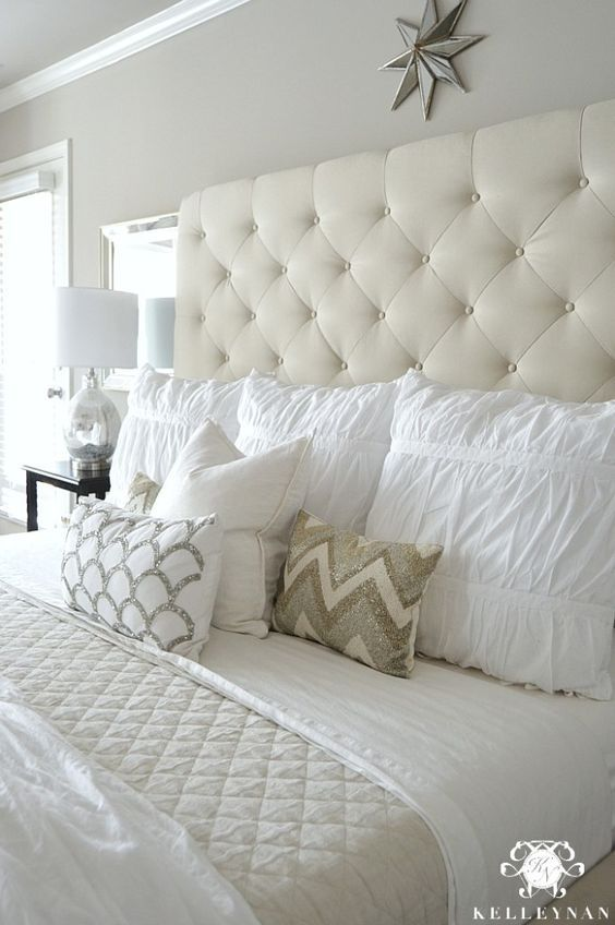 - Kelley Nan: Master Bedroom Update- Calming White and neutral master bedroom with tufted ottoman stools, Pottery Barn Tall Lorraine Headboard, Diamond linen quilt and hadley ruched duvetKelley Nan: Master Bedroom Update: