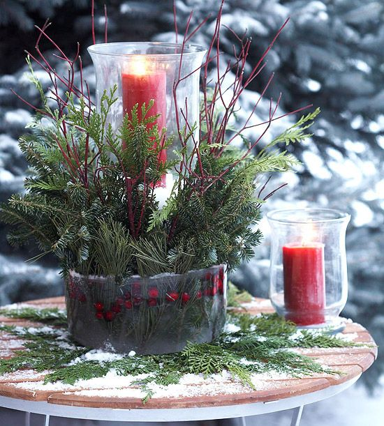 Evergreen-and-Cranberry Candle Ice Mold  A frozen ring of red-twig dogwood, evergreen cuttings, and cranberries warmly embrace a pillar candle. The tall glass holder lets the candle burn brightly -- and safely -- amid the branches. Use a flexible cake carrier to mold the icy arrangement.