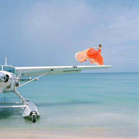 Photography by Rodney Smith. Girl on the wing of a plane