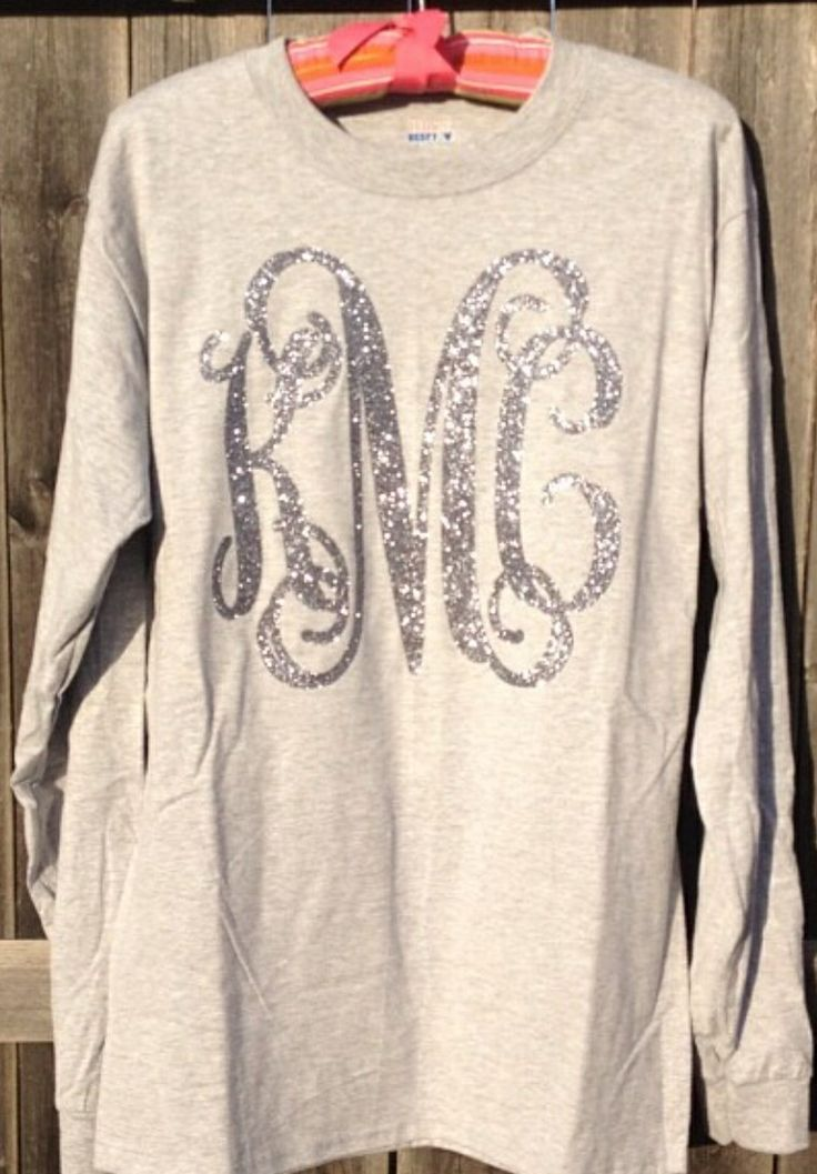 Love! Get a long sleeved shirt at Hobby Lobby and then use fabric paint, glitter, and stencils to create this cute piece
