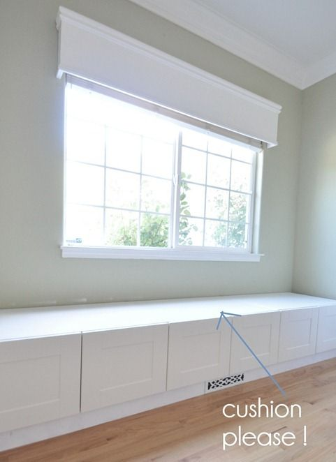 "window seat made with ikea refrigerator cabinets - 15"" high and 24"" deep plus support frame."