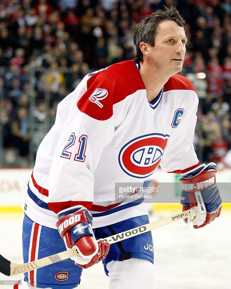 Former Montreal Canadien Guy Carbonneau skates during the Centennial Celebration ceremonies prior to the NHL game between the Montreal Canadiens and Boston Bruins on December 4, 2009 at the Bell Centre in Montreal, Quebec, Canada. The Canadiens defeated the Bruins 5-1.