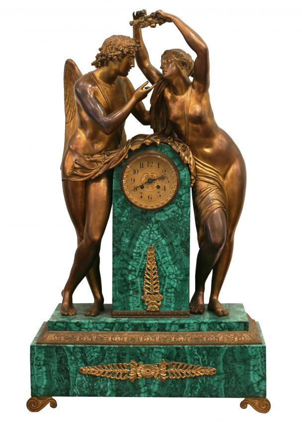 FRENCH GILT-BRONZE MOUNTED MALACHITE MANTEL CLOCK 19th Century. After a design by Claude Michallon (1751-1799) Centered by a column supporti...