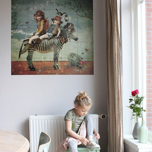 IXXI wall decoration made by blogger Kinderkamerstylist. With photos of her children, she made this illustration of her kids sitting on a zebra. There is no doubt her kids love this IXXI. The IXXI in this example will cost $84.45 (own images, 100 x 100 cm). #ixxi #ixxidesign