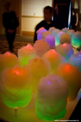 Glowing Cotton Candy - TO do this simply use Glow Sticks or Flashing Light Up wands as the sticks - GENIUS !!