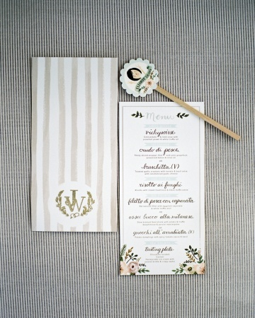These whimsical menus matched sweet swizzle sticks featuring a cute illustration of the couple's matchmaker