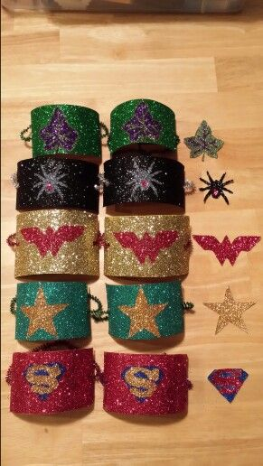Toilet paper rolls and tons of glitter = Superhero bracelets