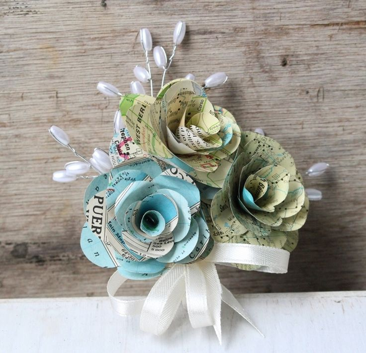 Paper flower corsage made with Map paper..see more at www.thepaperflorists.com