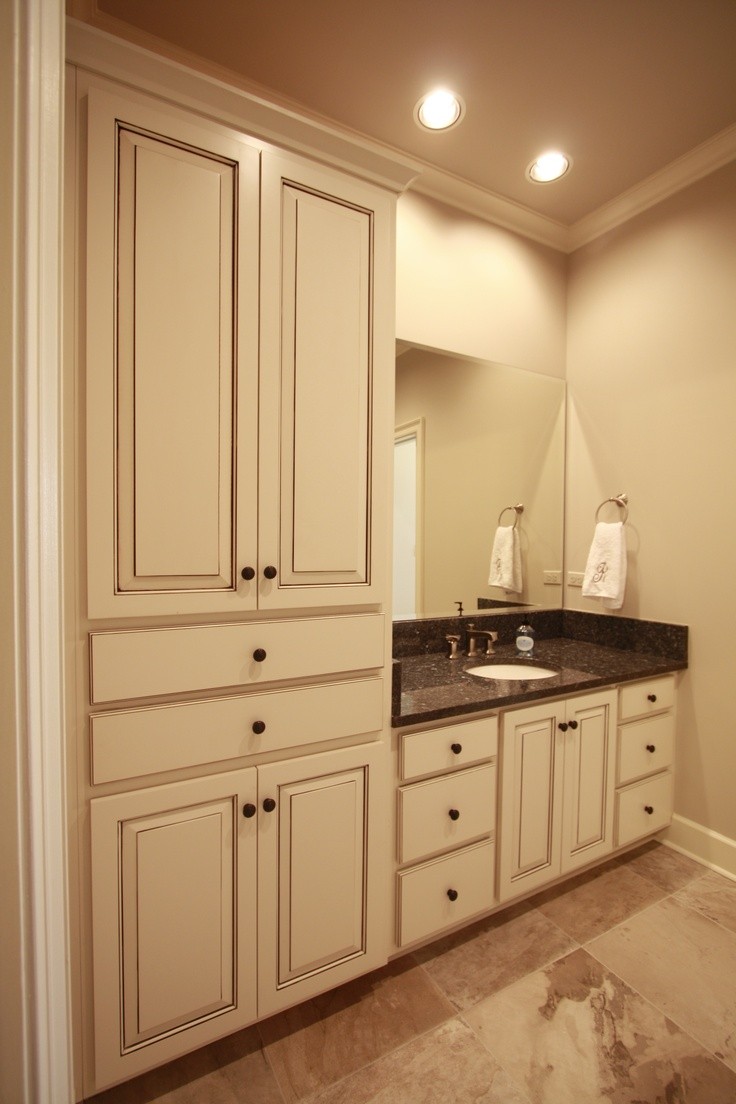 Gallery One The paint accents on these maple bath cabinets add so much interest The raised panels