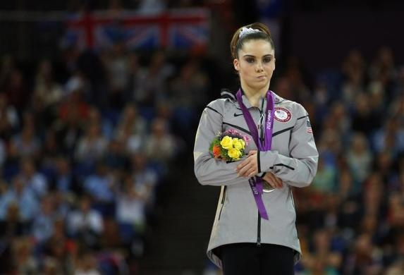McKayla Maroney of the U.S. celebrates with her silver medal in the women's vault victory ceremony in the North Greenwich Arena during the London 2012 Olympic Games August 5, 2012.   REUTERS/Brian Snyder