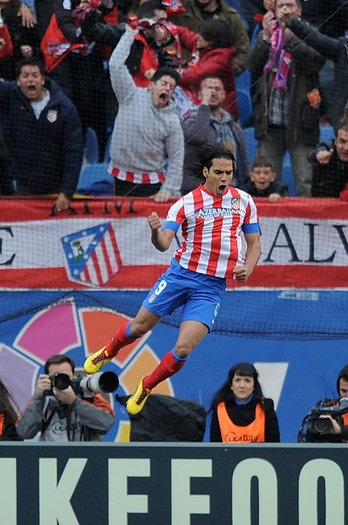 Radamel Falcao of Atletico de Madrid celebrates after scoring his teams opening goal during the La Liga match between Atletico de Madrid and Real Madrid at estadio Vincente Calderon on April 27, 2013 in Madrid, Spain. (Photo by Denis Doyle/Getty Images)