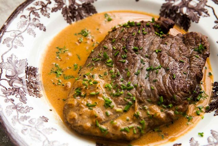 Steak Diane in a mustard sauce serve with shallots, thyme and mushrooms , boiled veggies and mash