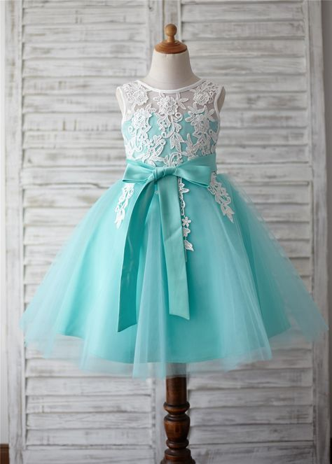 The materials for this dress is lace appliques and tulle.The listed color is turquoise bottom and ivory lace appliques overlay the top.It features detachable sash around the waist and v back.It is in knee length.the lace color will be as pictured no matter which color dress you order.Perfect for wed