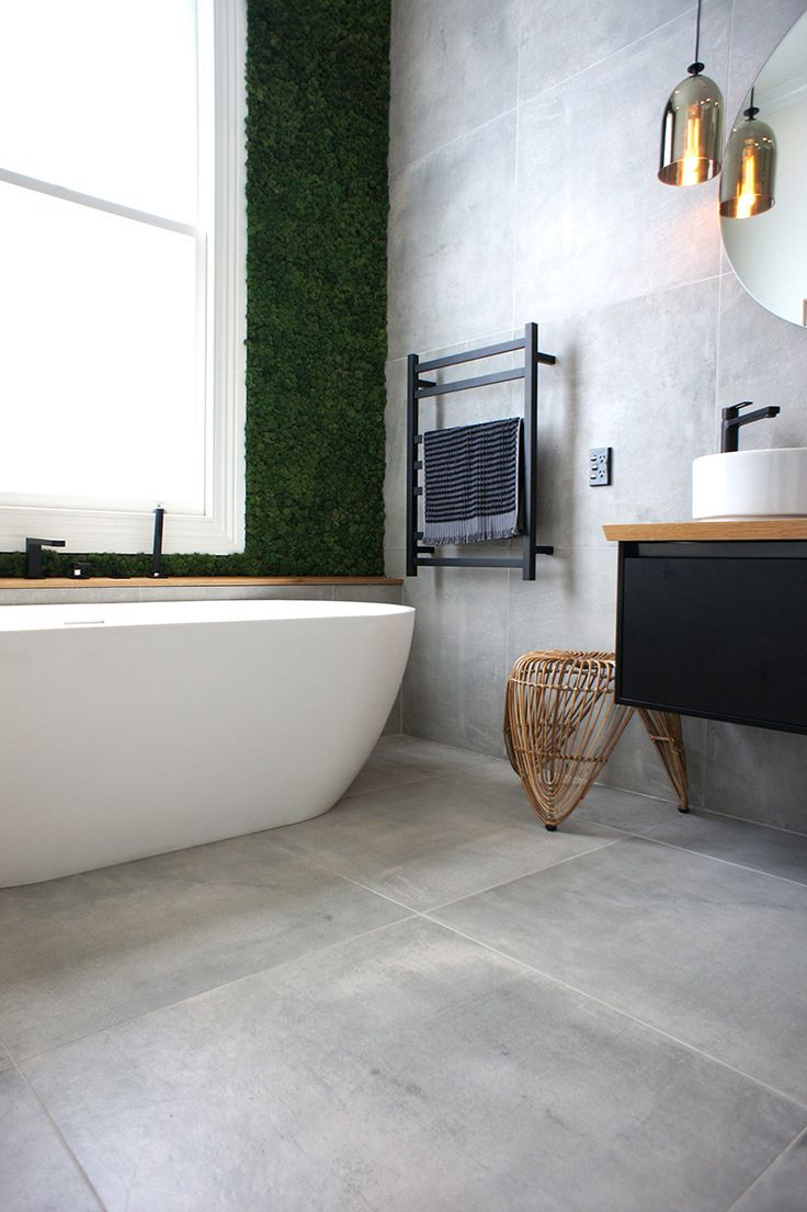 Cat & Jeremy's main bathroom, featuring the moss wall! The tile is called Cementia Grey 75