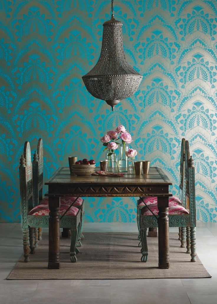 "Discover printed wallpapers by British fashion designer Matthew Williamson for Osborne & Little. Designs include the peacock, flamingo and dragonfly.  ""I never tire of the peacock's majestic, symmetrical beauty. I wanted to capture its essence but in a fresh new way so set about a graphic repeat pattern using solid blocks of colour and treating the design as if it were a fine, intricately-woven lace."""