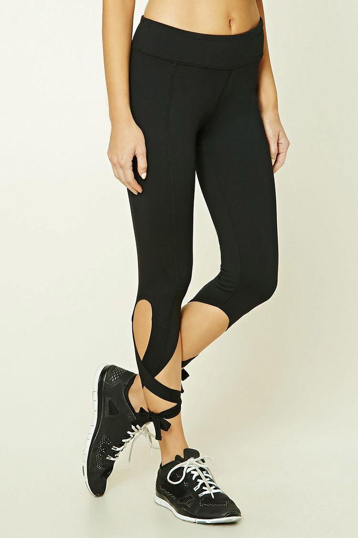 A pair of stretch-knit yoga capri leggings featuring a self-tie hem, hidden key pocket, and moisture management.