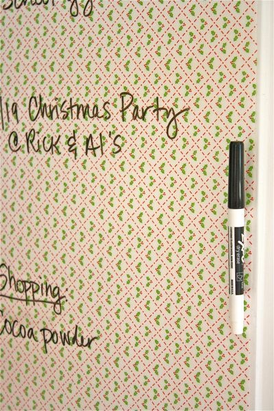Fabric covered with sticky clear contact paper = pretty dry erase board.  Do this for the top of the kid's table!