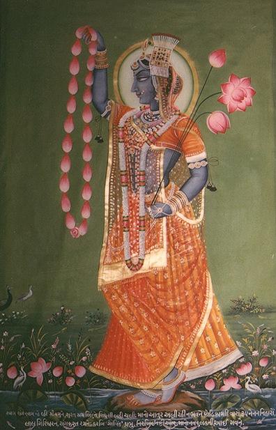 Yamuna Devi..orange dress and pink flowers..I like Yamuna Devi