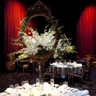 Table mirror feature flower arrangement. For more event flower designs please go to www.naomijones.com.au.