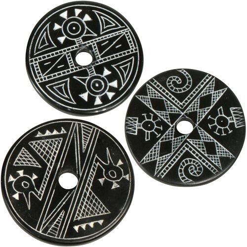 "Coal Pendants with Duck Designs  Crafted by Artisans in Colombia  Measure 1-3/4"" diameter and 1/8"" thick"