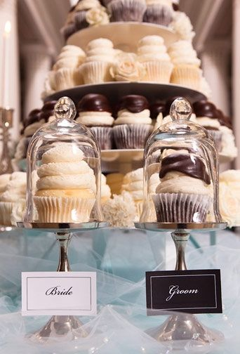 Love everything about this. Cupcake tower with brides choice and grooms choice. Fun  and beautiful