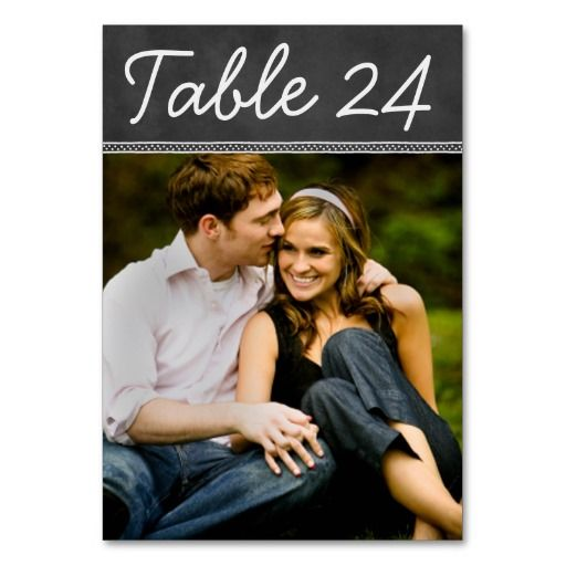 "Chalkboard Wedding Photo Table Number Card  To order: use ""Personalize it"" on the product page to type in the table number and click ""change"" by the default photo to upload your own wedding engagement photo, then add that individual table number card to your shopping cart. Repeat for all of the table numbers that you need. Text and divider design have a soft white hand-drawn chalk look on a background that has a textured black chalkboard appearance."