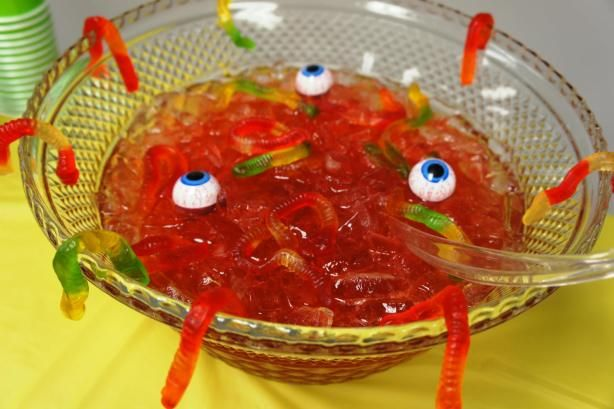 Creepy Halloween Punch – Credit: 7 Layer Studio  1 can frozen lemonade (I used Minute Maid)  2 cans water  1 pkg black cherry Koolaid  1/2 c sugar  2-liter bottle of Ginger Ale  Lots of ice  Gummy worms to drape over the sides of the bowl Floating eyeballs (these seriously make the punch cool!)