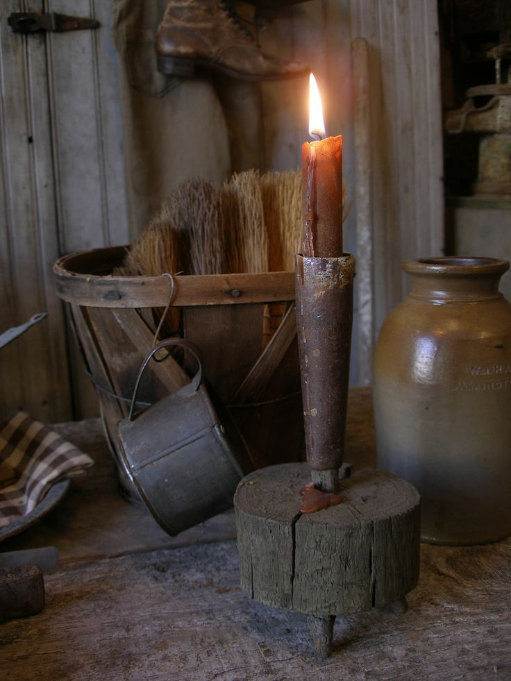 Primitive early style candle holder