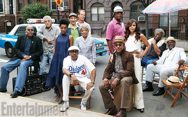 Do the Right Thing (2013) (Left side) Spike Lee (seated, front); Joie Lee, Ruby Dee (standing behind Spike Lee); Bill Nunn, Frank Vincent, Richard Edson, Ricky Aiello (back row, left to right) (Right side) Giancarlo Esposito (seated, front); Samuel L. Jackson, Rosie Perez (standing behind Giancarlo Esposito); Paul Benjamin, Frankie Faison (seated under umbrella)