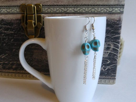 These turquoise skulls dangling earrings are a great gift idea for women. The skulls with dangling silver chains are fun and feminine, and a great size for a stocking stuffer! See my other listings for more skull earrings. Thank you for shopping handmade! Felicia :)