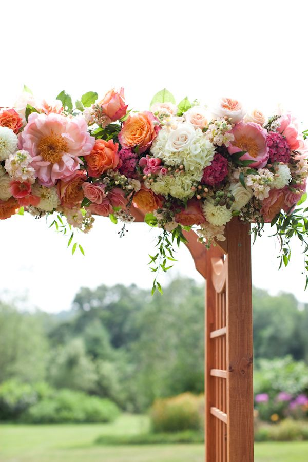 Peach, pink and white floral wedding arbor. #weddingflowers #peachypink #peachypink http://www.weddingchicks.com/2013/10/30/peach-and-cream-garden-wedding/?preview=true&preview_id=366060&preview_nonce=a45d8e038a