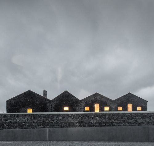 nexttoparchitects:  Menos é Mais + João Mendes Ribeiro, art center in the Azores Contemporary Art Center engages in dialogue with the volcanic landscape of the Azores in Ribeira Grande, a municipality on the Portuguese island of San Miguel. Winner of a competition held in 2007, the project for the cultural facility sought continuity between an old alcohol and tobacco manufacturing plant on one hand, duly renovated, and two new buildings on the site, unifying the scales of different periods…