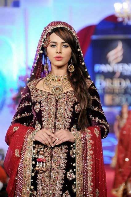Pakistani bridal couture, red, gold, velvet, the model is Ayaan Ali