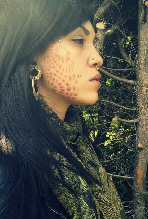 Scarification after it heals! Turned out nicely on her, although I wouldn't get scarification on my face, it seems as though it would take forever to heal