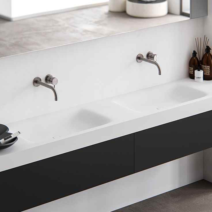 Wave encapsulateds smooth, gentle contours that seamlessly blend into the countertop in a natural motion. With clean lines and curvaceous appeal, it is available in three sizes to complement both classic and contemporary settings. Smooth edging for easy cleaning. Completely made to measure washbasin out of HI-MACS (solid surface). Featured: Double top mounted Wave Alpine white HI-MACS washbasin with a wall mounted Fenix NTM cabinet.