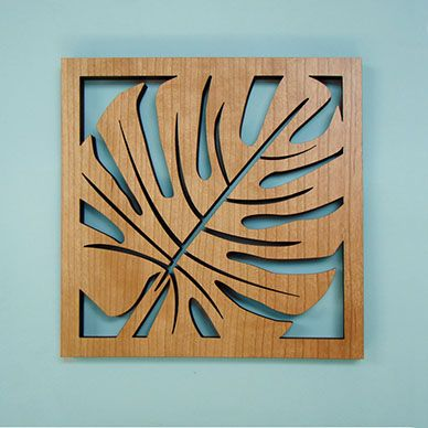 Bring the Island feel to your home with this tropical leaf trivet. Great place for your serving dishes at your next dinner party.  This cherry wood veneer finished trivet has precision laser cut detail, cherry veneer with a heat absorbing MDF core, and cushioned feet.  Made in the USA.   7.75&