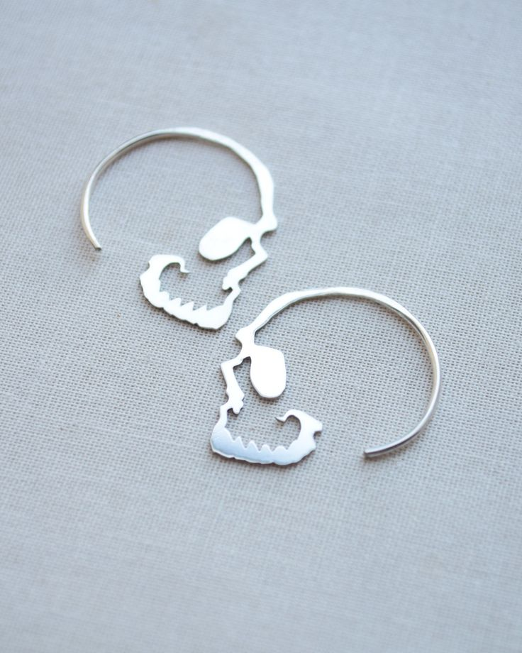 Our silver skull hoop earrings are the perfect accessory with a little edge. These are handmade with love in sterling silver and measure 1 inch by 1 inch. Such a unique take on skull earrings!  SLVH ♥♥♥
