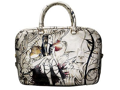"Prada cervo lux Prugna    print ""Faeries"" by ArtistJames Jean   circa 2008   This bag & I have a love affair -I want want I can't have ---- Because I can't find one to own!!! flew to NYC  in 2008 for this Bag -SOLD OUT - managed to buy the small purse .... a token gesture for my dissapointment!! I HAVE to Want to WILL ...OWN this Prada Bag! any one have  one for sale??? GENUINE (with receipts & ownership Prada plastic authenticity cards) -comment inbox me"