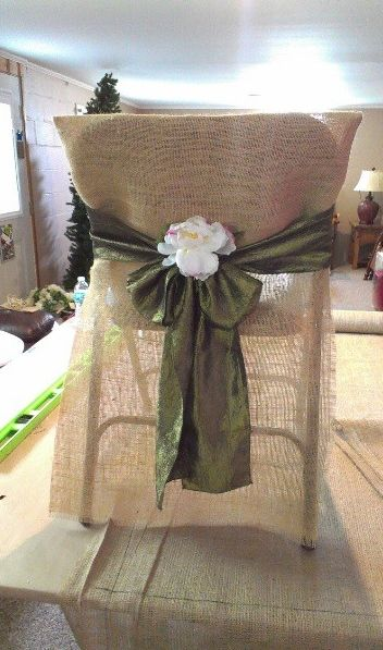 Just a thought burlap bags are cheap and this combo with ribbon would probably look better than the cheaper chair rentals. Would do a navy ribbon with bow (no flower or wheat stalks if we wanted), then table runner would be navy as well