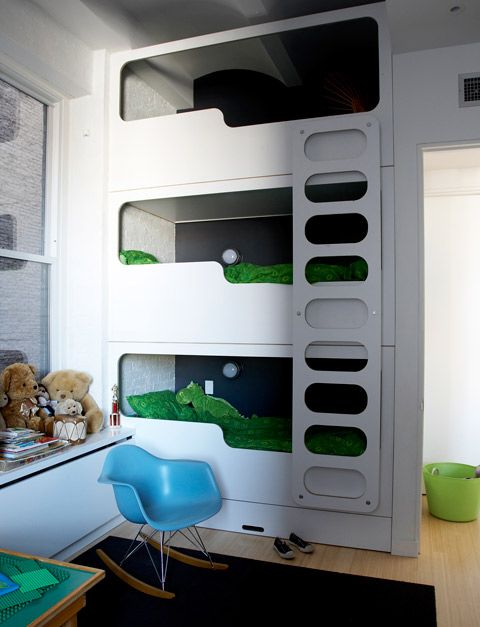 Retro lines triple bunk beds for small spaces with many little faces :P and it gives a futuristic space feel to them