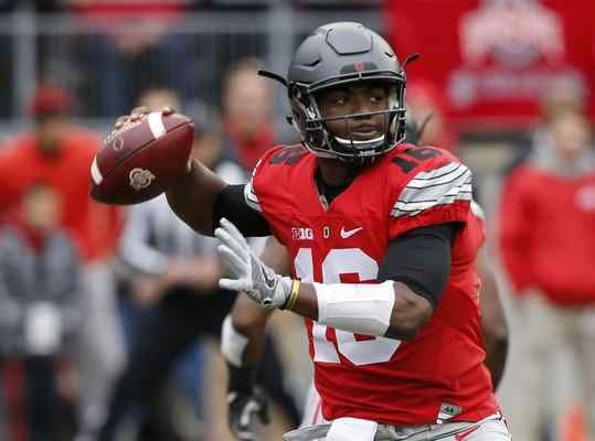 Ohio State quarterback J.T. Barrett drops back to pass against Michigan during the first half in Columbus in November.