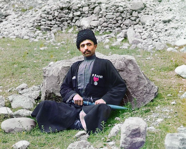 """PROKUDIN-GORSKII  - 1907-1915: Russia Before the Revolution, in Color /  ca. 1907-1915:  Dagestan, meaning """"land of mountains"""" in the Turkic languages, contains a population consisting of many nationalities, including Avars, Lezgi, Noghay, Kumuck and Tabasarans. Pictured here is a Sunni Muslim man of undetermined nationality wearing traditional dress and headgear, with a sheathed dagger at his side."""