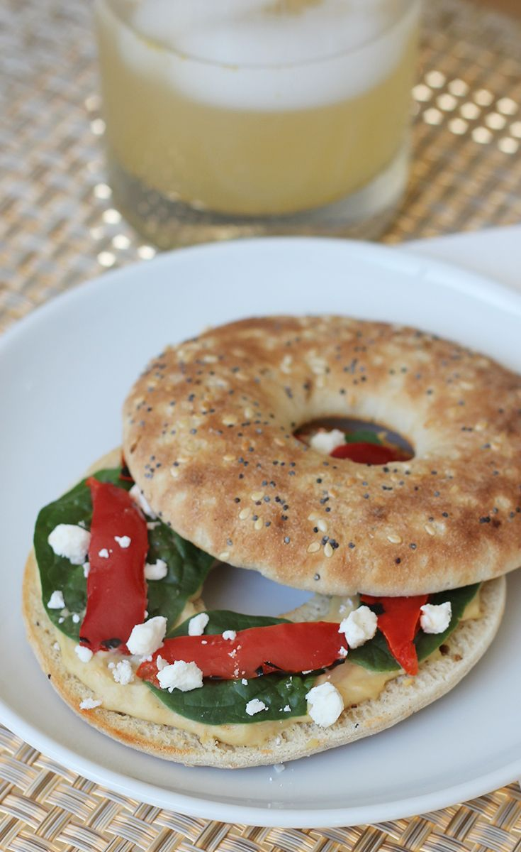 ... bagel with hummus, roasted red peppers, baby spinach and Feta cheese