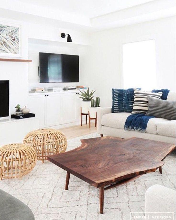 White walls, wood floors, gorgeous wood slab coffee table, indigo mudcloth pillows | A little indigo inspiration from @amberinteriors on Loom & Kiln instagram