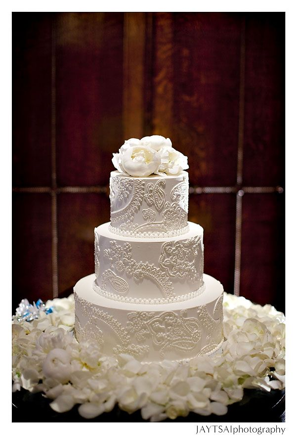 So beautiful... I just love intricate white buttercream cakes.  Love the combo of fresh and fondant flowers