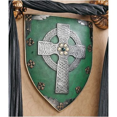Great idea for my living room. Honey colored walls, deep green furniture, Celtic inspired throw pillows, and pictures of Scottish castles and such.. like this sheild too.