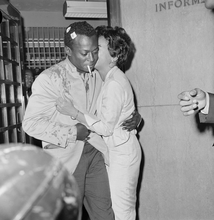 """""""Jazz is the big brother of revolution. Revolution follows it around."""" Miles Davis is kissed by his wife, as he is released from jail in 1959"""