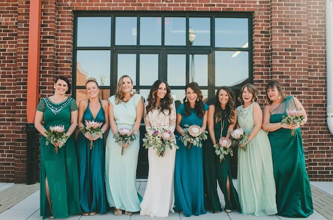 Bridesmaids in teal, emerald + mint dresses